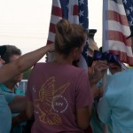 Field Of Honor Veterans Tie Bows To Flags