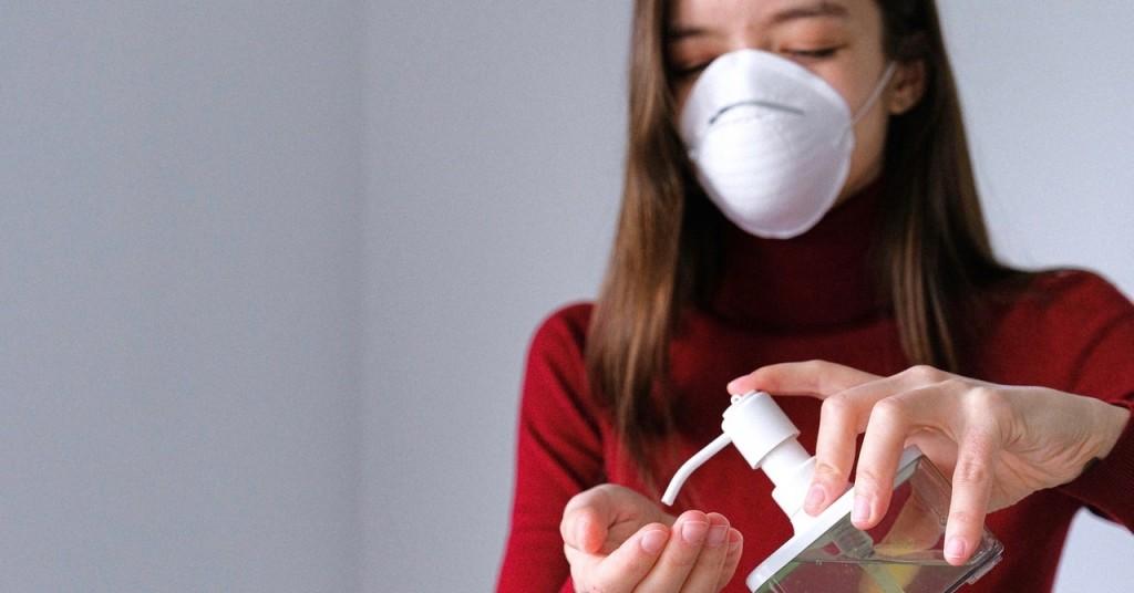 Woman Applying Hand Sanitizer 3987146
