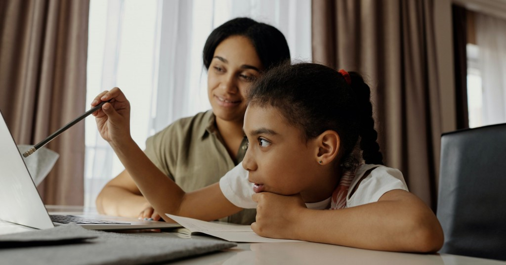 Mother Helping Her Daughter With Homework 4260315 2