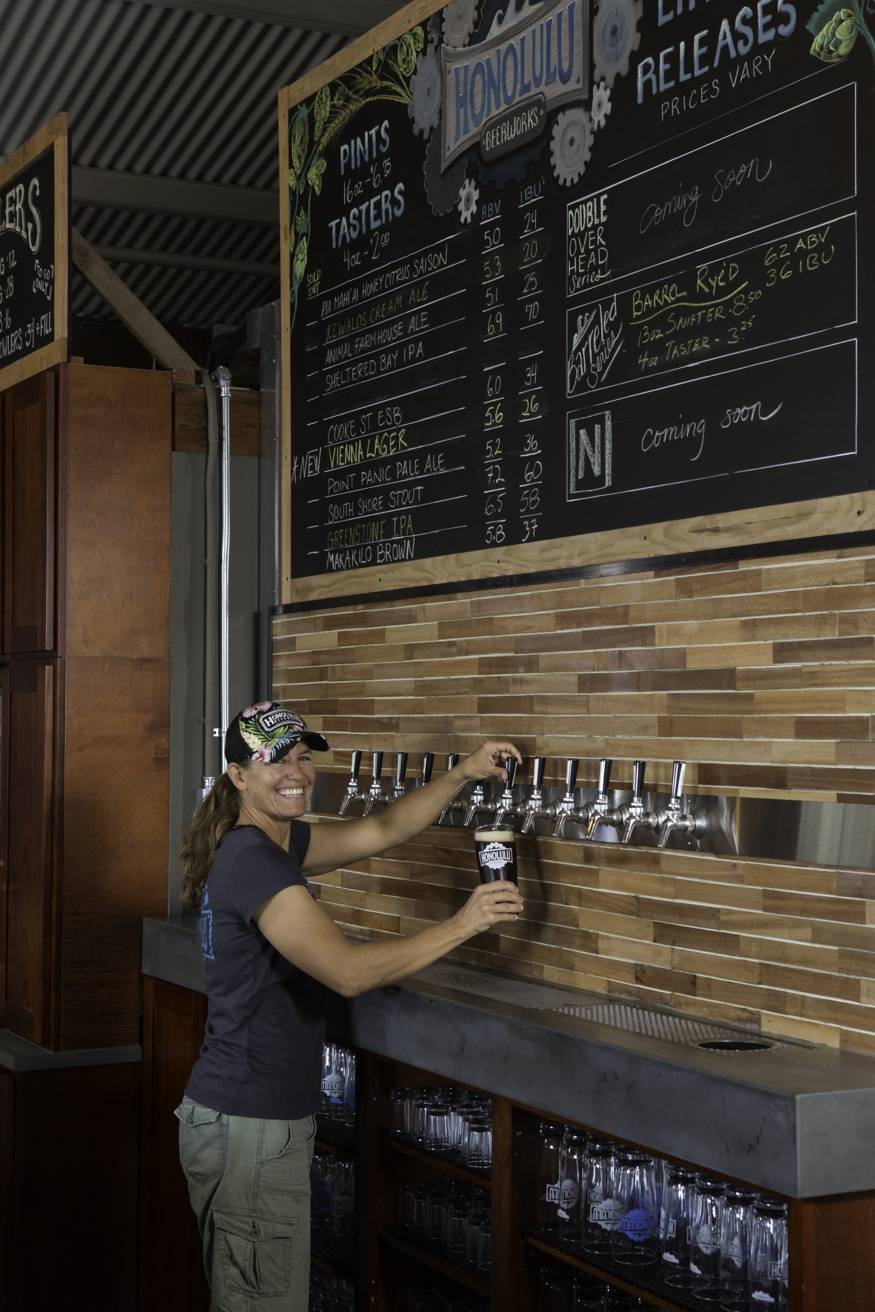 Roxayne Spruance pours a glass at Honolulu Beerworks. Photo: David Croxford