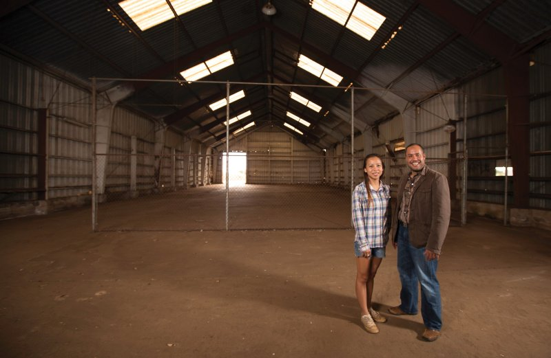 Shin Ho of Ho Farms and state Sen. Donovan Dela Cruz stand in an old warehouse outside Wahiawa that Ho Farms plans to renovate into a food-safety facility. Dela Cruz hopes the Whitmore Project can convert the remains of Wahiawa's pineapple plantations into the infrastructure for a diversified agriculture center. Photo: David Croxford