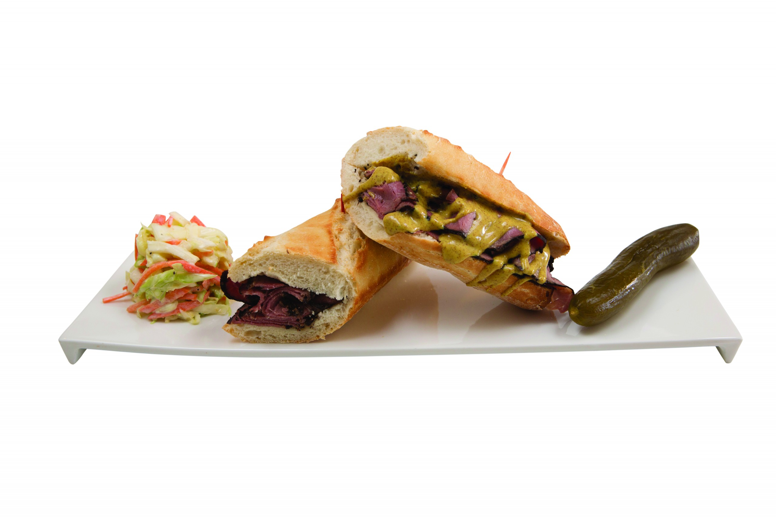 Pastrami sandwhich on a french baguette with spicy dijon mustard, house coleslaw and a kosher dill pickle. Photo: David Croxford