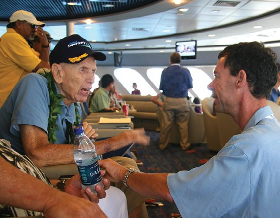 Tim Dick, right, founder and CEO of the Hawaii Superferry, rides the ship with retired Rear Admiral E. Alvey Wright, a former commander of the Pearl Harbor Naval Shipyard and later an advisor to the Superferry. Photo: Susan Benay