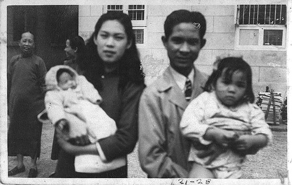 """Eddie Flores Jr. with his parents and sister in Hong Kong. Flores remembers his experience as an immigrant to Hawaii and he says that's why he often chooses immigrants as franchisees. """"We target them because, working any place else, they make minimum wage. Here they can own a restaurant and make a lot of money."""" Photo: Courtesy of L&L."""