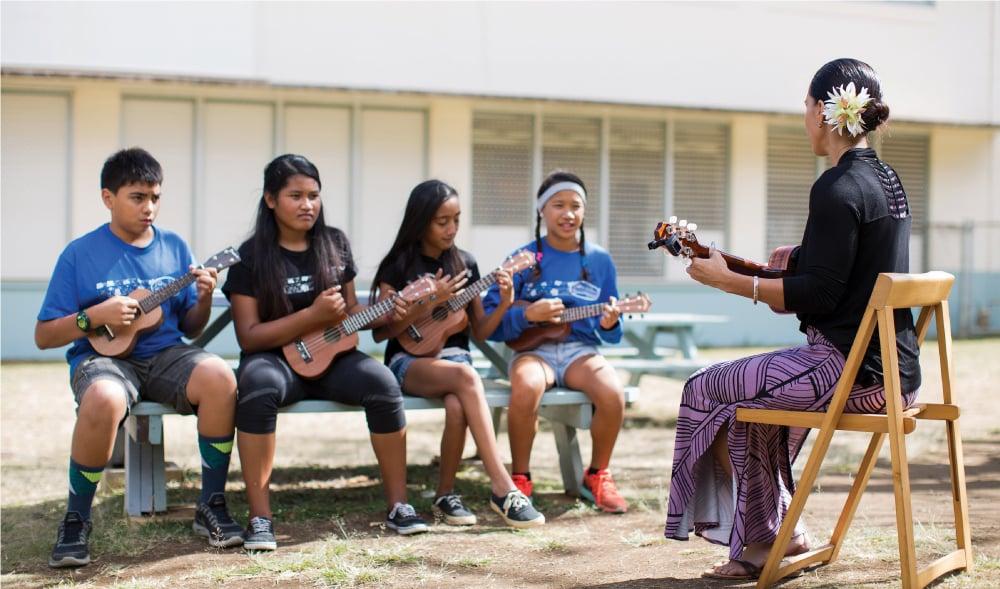 At Stevenson Middle School, volunteer Mandy Lyman teaches an after-school ukulele class. Photo: Sean Marrs