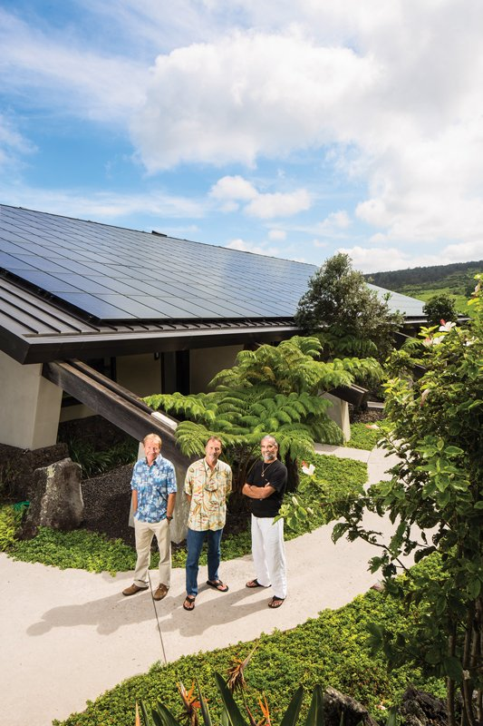 Henk Rogers, at Puuwaawaa Ranch, his home on Hawaii Island, with his Blue Planet Energy Systems co-founders, Aleks Velhner, left, and Vincent Paul Ponthieux. They are standing in front of the energy lab, with solar panels on the roof, and battery storage and hydrogen fuel cells inside. Photo: Olivier Koning