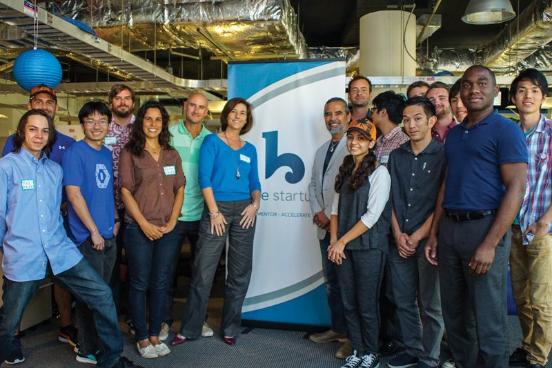 Henk Rogers launched the Blue Startups accelerator in 2012 with his daughter, Maya. Managing director Chenoa Farnsworth and Henk Rogers are at center, surrounded by entrepreneurs they are mentoring. Photo: Courtesy of Henk Rogers