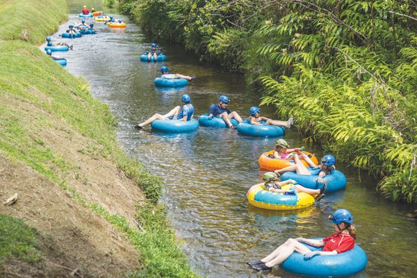Customers of Kauai Backcountry Adventures ride inner tubes down canals that once irrigated sugar plantations. Today, the company has exclusive rights to run excursions on the canals. Photo: Kauai Backcountry Adventures