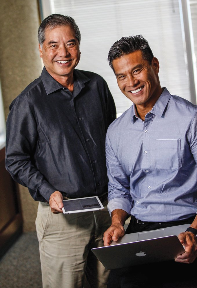 Dan Arita, left, the founder of DataHouse, and his son, Creighton Arita, the CEO of ike, the parent company of DataHouse, TeamPraxis and Sagely. They have created companies that deliver services nationally and globally by leveraging Hawaii's unique attributes. Photo: Olivier Koning