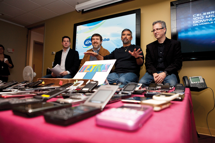 Henk Rogers and Alexey Pajitnov are flanked by executives of the game company EA, which currently licenses the rights to Tetris on mobile phones. Photo: Courtesy of Henk Rogers