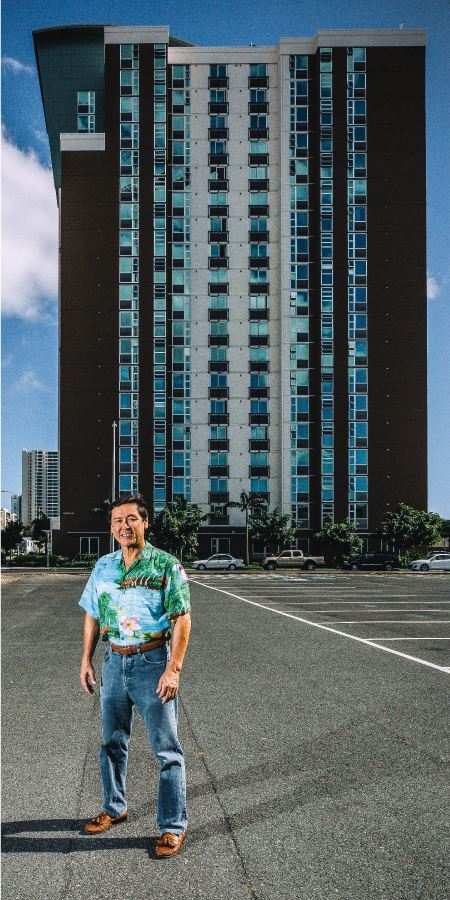 Developer Stanford Carr stands in front of Halekauwila Place, a 204-unit affordable rental project that he finished in Kakaako in 2014. Rents and other income were far too little to cover the cost of construction, so Carr made up the difference with federal and state tax credits and a loan from the Hawaii Community Development Agency.