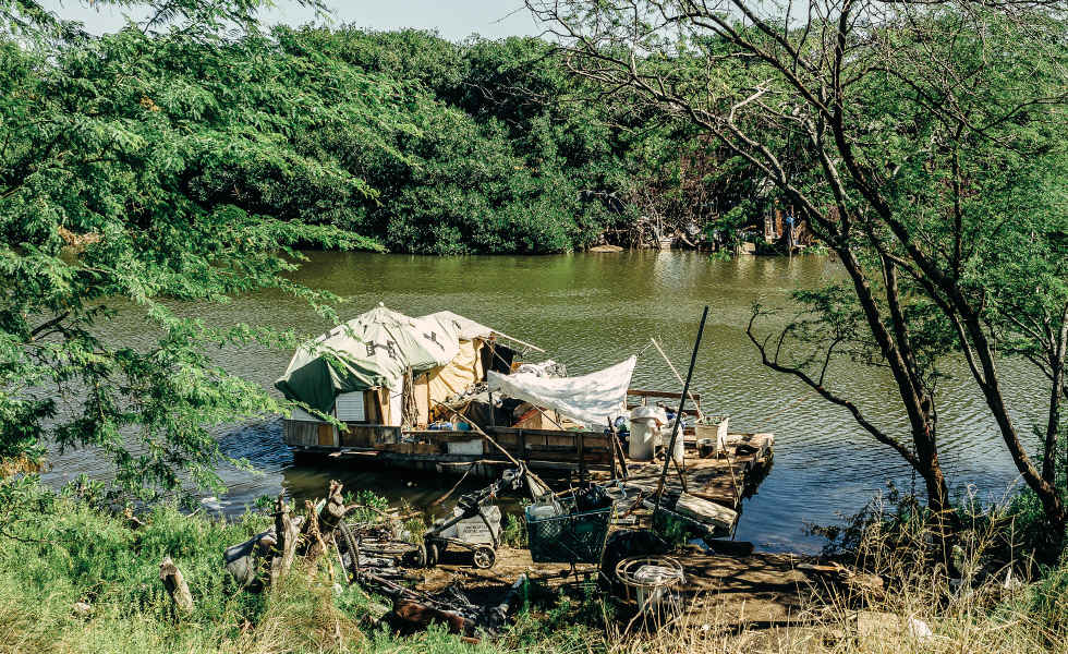 There is already a homeless community occupying this state land along Keehi Lagoon. Many of the residents live in floating shacks or primitive homesteads in the brush. Photo: Aaron Yoshino.