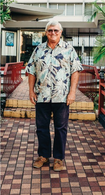 Peter Savio stands at Honolulu's Pagoda Hotel; in the background is Rycroft Terrace, once part of the hotel, which Savio turned into 162 affordable housing units. The conversion helped fulfill Kamehameha Schools' affordable housing requirements for its Kakaako development. Rycroft condos sold in 2014 for as low as $123,480 for a studio and as high as $274,990 for a two-bedroom apartment. Savio favors affordable-housing sales, not rentals.