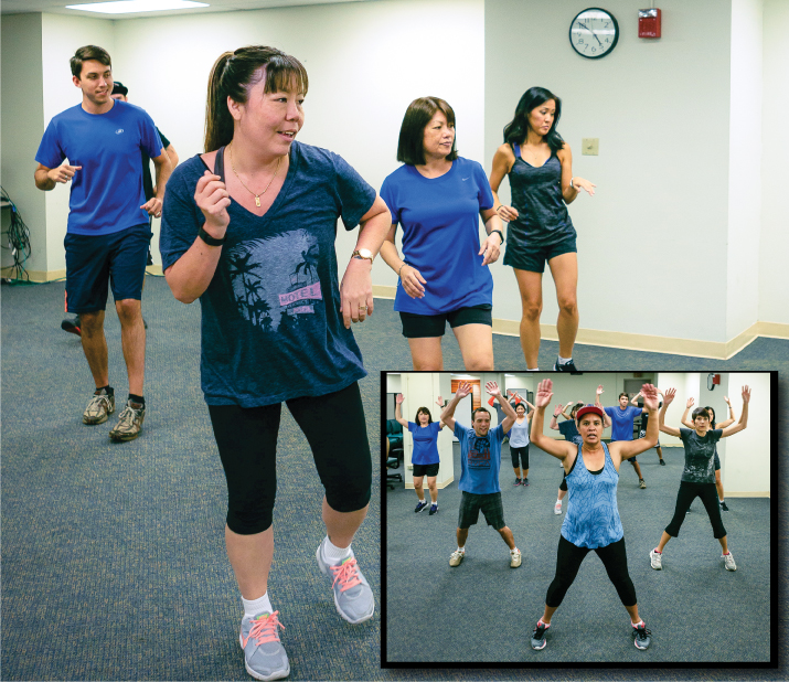 Lori Buendia, front, regularly attends the exercise classes that Island Insurance sponsors in its downtown headquarters. Inset photo: Kim Koki leads the Zumba class.