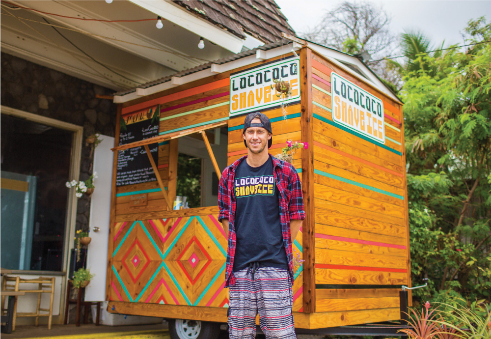 Thomas Oliver is the owner of LocoCoco Shave Ice, a trailer parked outside Kukuiula Market. Oliver says he grew up near the market and has always known the Kuribayashi family that owns the store. Photo by Brian Finch.