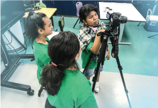 Seventh and eighth grade students work on a sustainability project during teacher Ethan Toyota's Global Issues and Video Production class at Ewa Makai Middle School. For their final project, the students took the role of an advertising agency to create three short videos that try to persuade high schoolers to be more environmentally friendly. The students refined and focused their messages, and used the blue screen, animations and other production techniques to create the videos. Photo provided by Ewa Makai School.