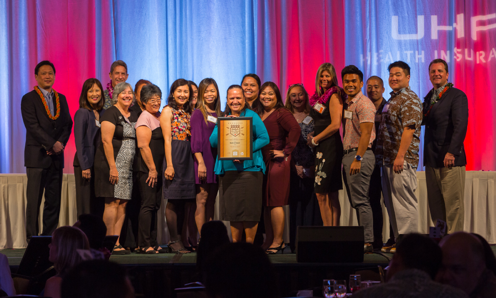 The team at Bank of Hawaii receives their award for Top Family Friendly Workplace in the Large category. Photo by Aaron K. Yoshino.