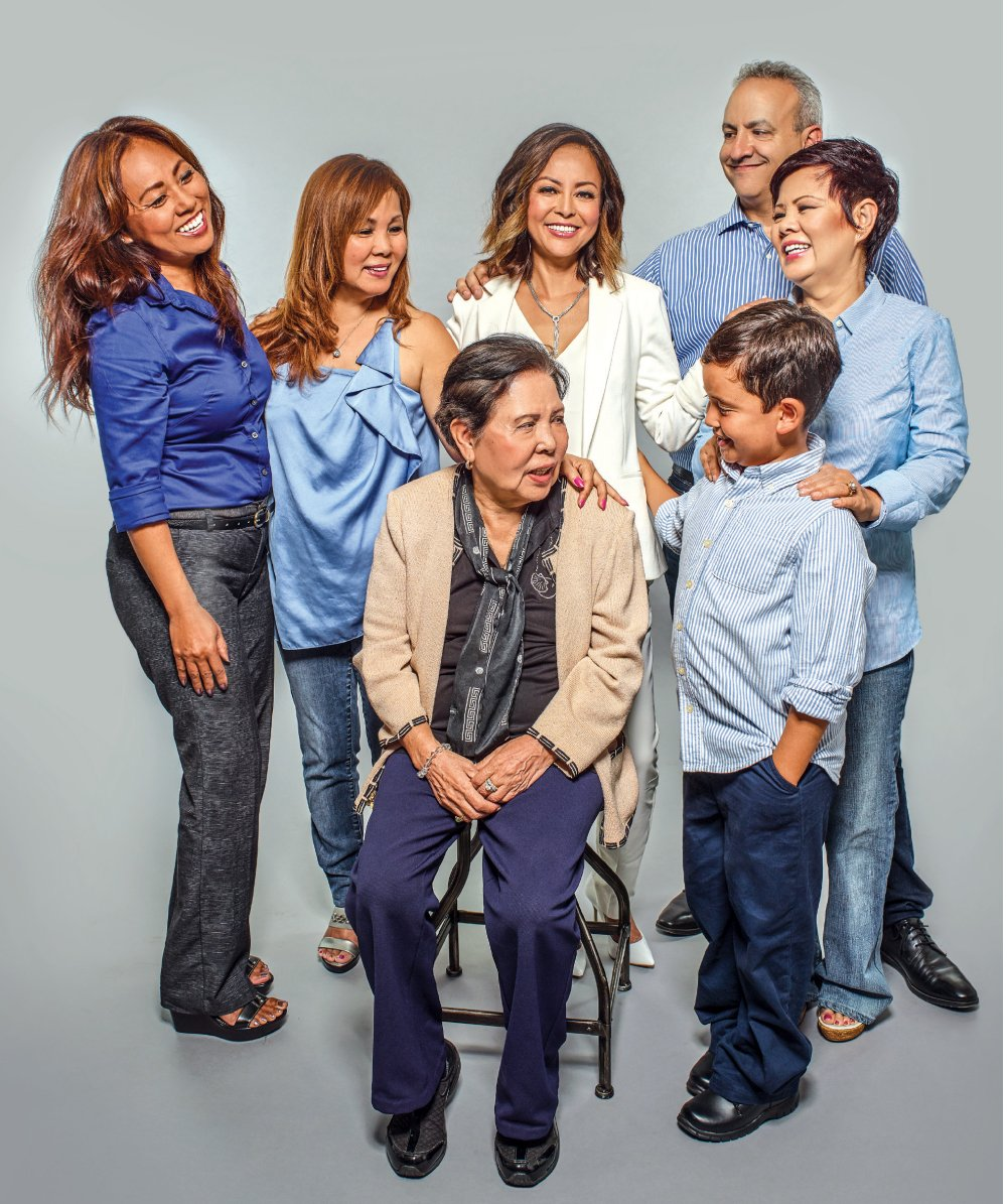 In front are Christine's mother, Judy Camp, and son, Ethan; from left, her older sisters are Elizabeth Yamaguchi, June Freundschuh and Frances Muneno; at right is boyfriend Alan Schlissel.