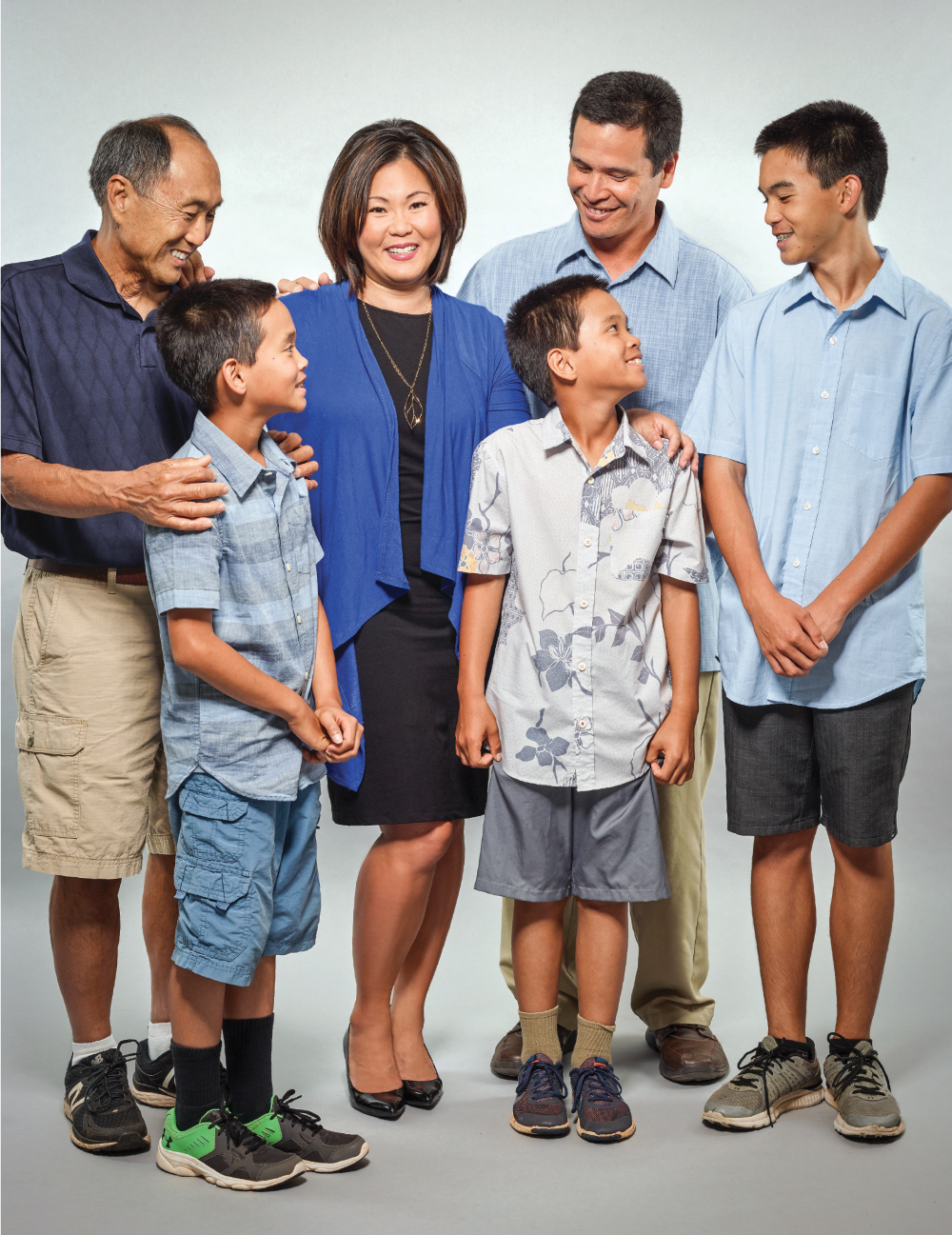 Grandfather Randy Kim and, from left, sons Eli, Simon (both 10) and Sam (14), and husband, Edwin Sniffen. Not pictured is grandmother Beverly Kim.