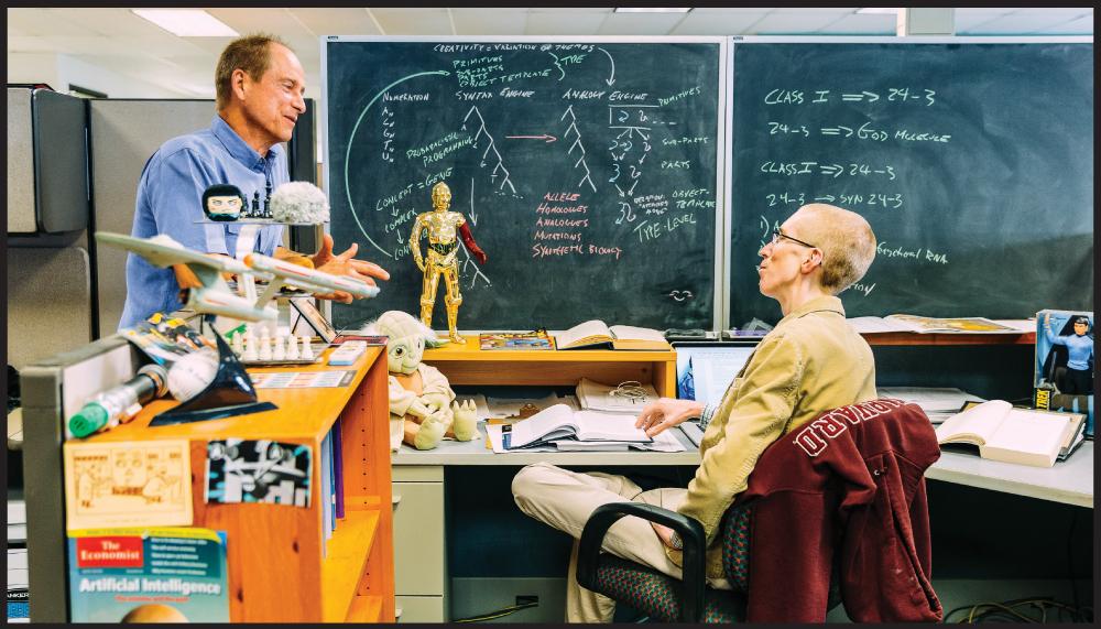 Patrick Sullivan talks with senior scientist Jeffrey Watumull. Photo by Aaron K. Yoshino