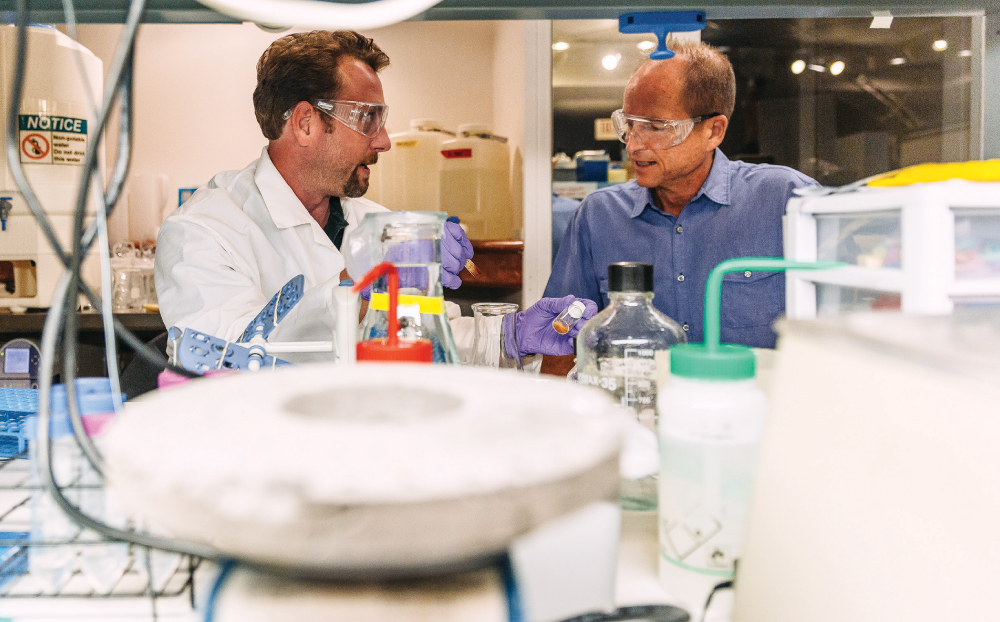 Senior scientist Jacob Pollock talks to Patrick Sullivan in the Nano-Bio Lab at Oceanit's headquarters on Fort Street Mall in downtown Honolulu.