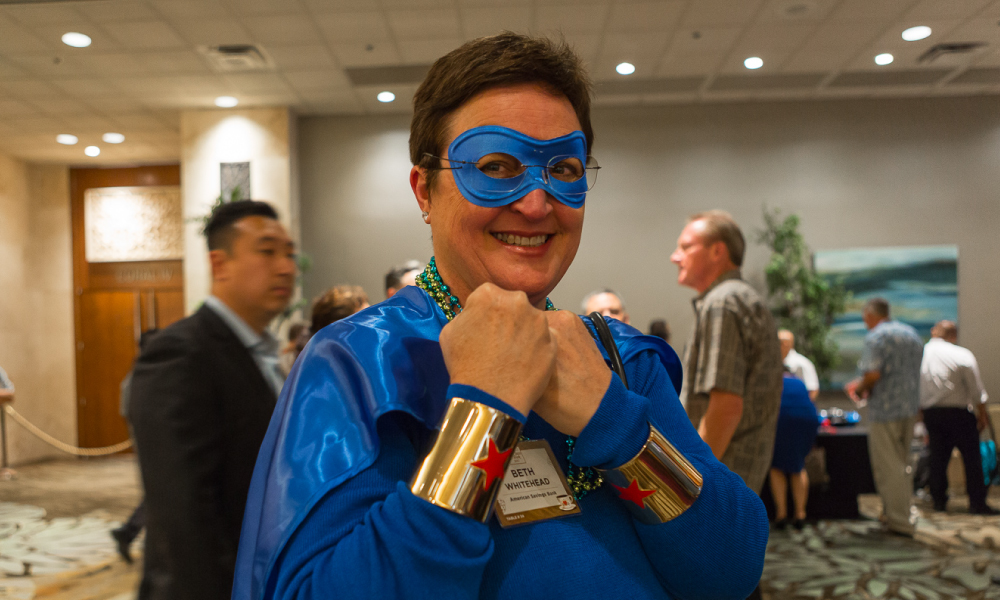 Beth Whitehead, Chief Administrative Officer at ASB dressed in superhero attire this year along with her team. Photo by Aaron K. Yoshino.