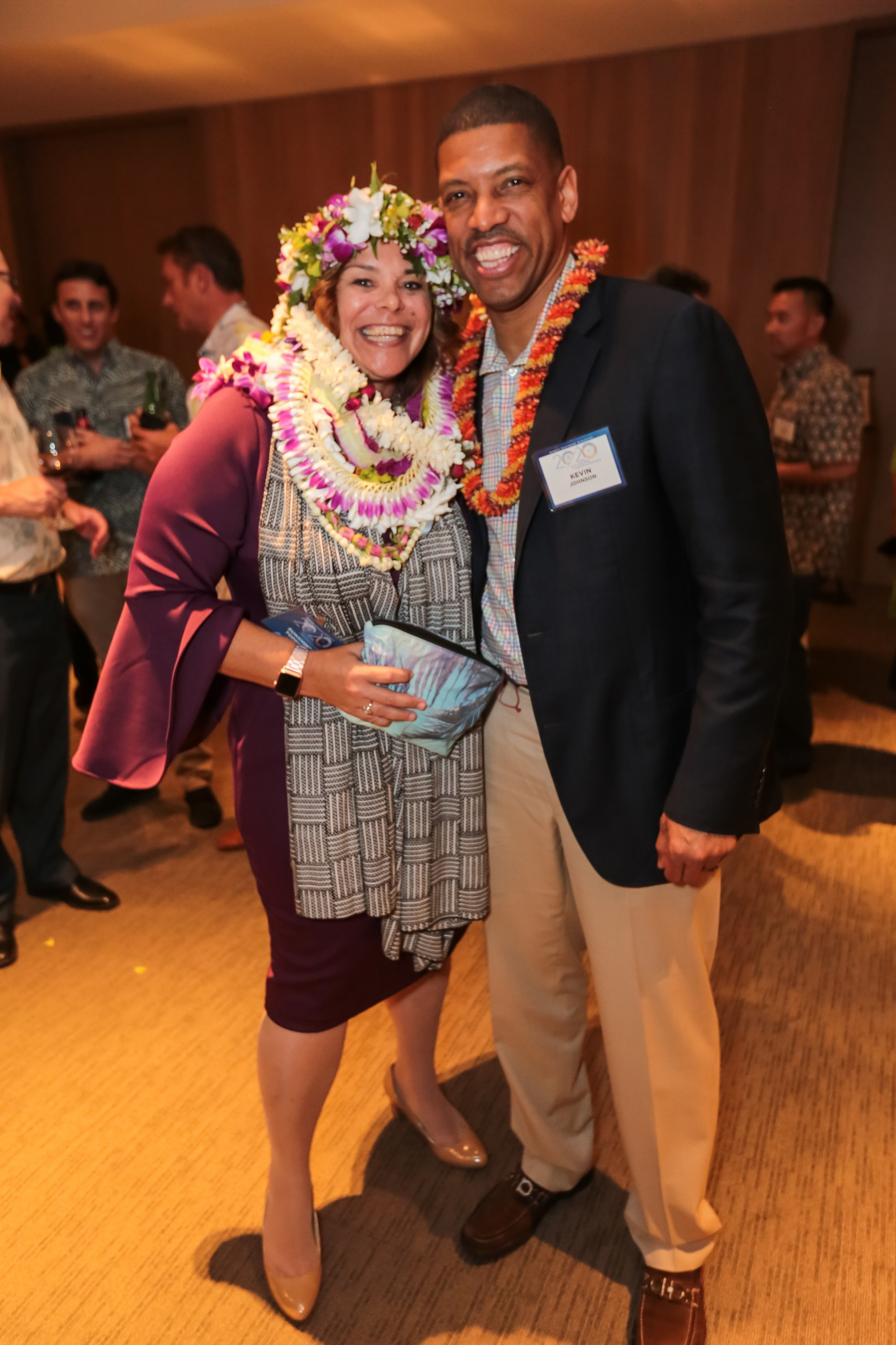 Sunshine Topping of Hawaiian Telcom with former NBA superstar Kevin Johnson. Photo by Travis K. Okimoto