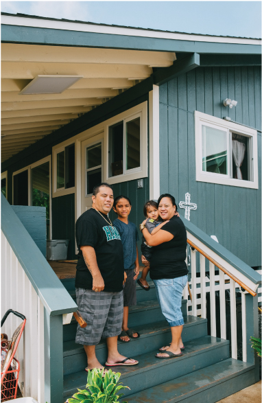 """The Santos family partnered with a nonprofit called Mustard Seed Miracle to build their home in Waimanalo. From left are Rusty Santos, Noa, 9, Isaiah, 2, and Kinohi """"Ola"""" Santos. Photo by Josiah Patterson."""