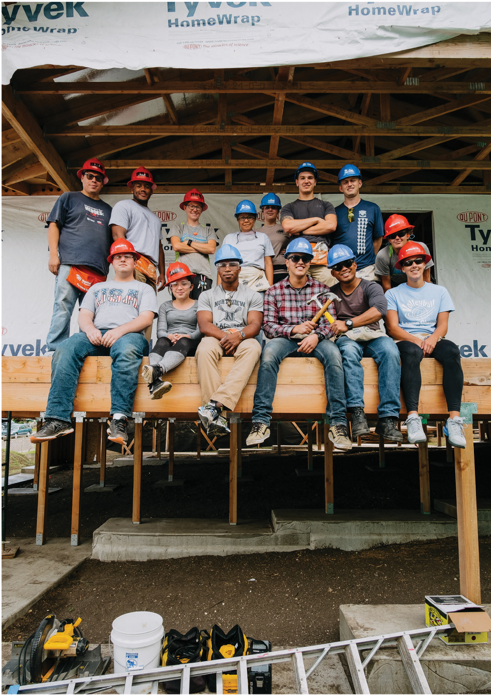 Volunteers from across Oahu rest while installing siding on a new home in Waimanalo. Jim Murphy of Honolulu Habitat says the home is scheduled to be completed in April for a Native Hawaiian woman, who is the single mother of three children.