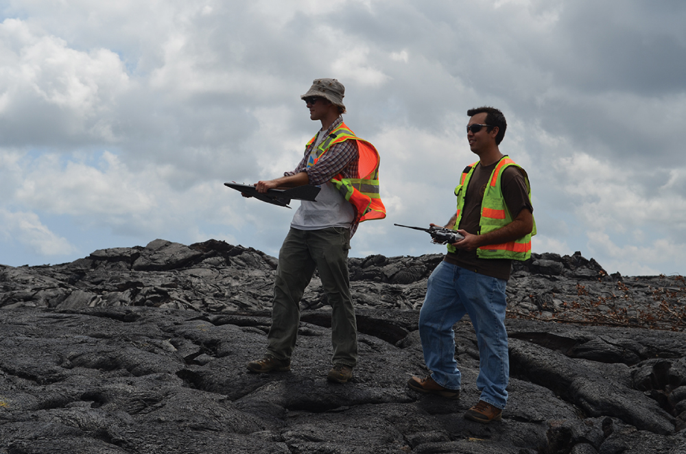"""Anything we can add to better predict lava flows is welcome."" says Ryan Perroy, assistant professor in UH Hilo's Dept. of Geography. He is shown holding an unmanned aerial vehicle that he uses to study lava flows. Photo courtesy Kevn Krajick/Earth Institute, Columbia University."