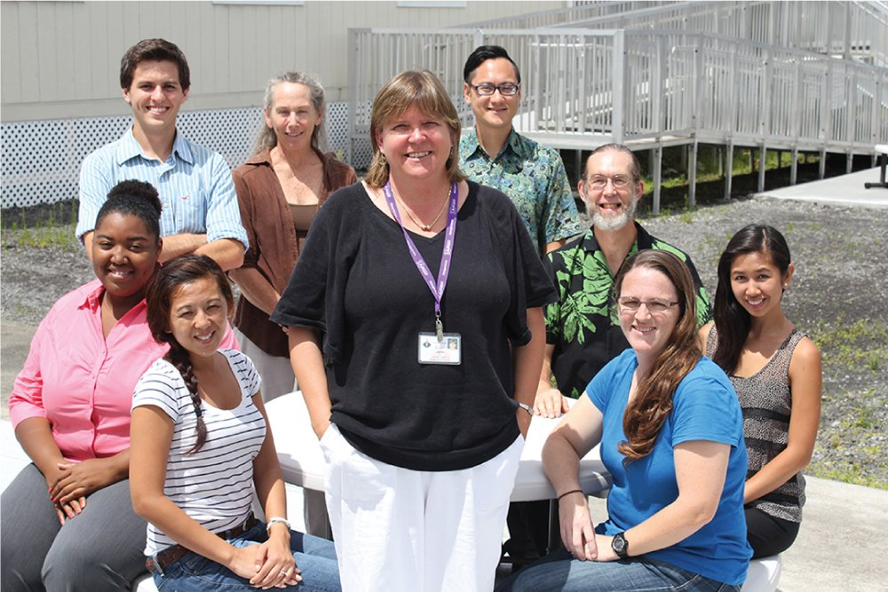Sue Jarvi (center) who helps lead the Hawaii island Rat Lungworm Working Group, is joined by, clockwise from Jarvi's right: Ann Txakeeyang, LaTasha Riddick, Michael Severino, Kay Howe, Akio Yanigisawa, Steven Jaquier, Jill Villarosa and Peggy Farias. Photo courtesy Daniel K Inouye College of Pharmacy.