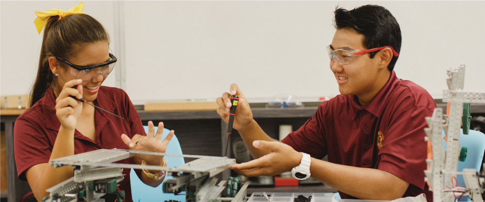 Maryknoll high school students learn critic al thinking through hands-on projects in robotics and engineering courses.
