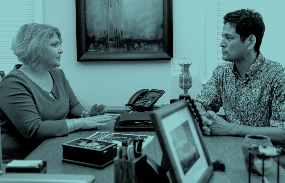 Denise Konan and Nori Tarui, an associate professor of economics, in her UH office. Photo: Aaron K. Yoshino