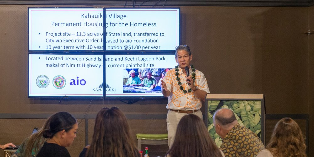 Kurisu presents an outline of the beginning phases of Kahauiki with aio employees. Photo by David Croxford.