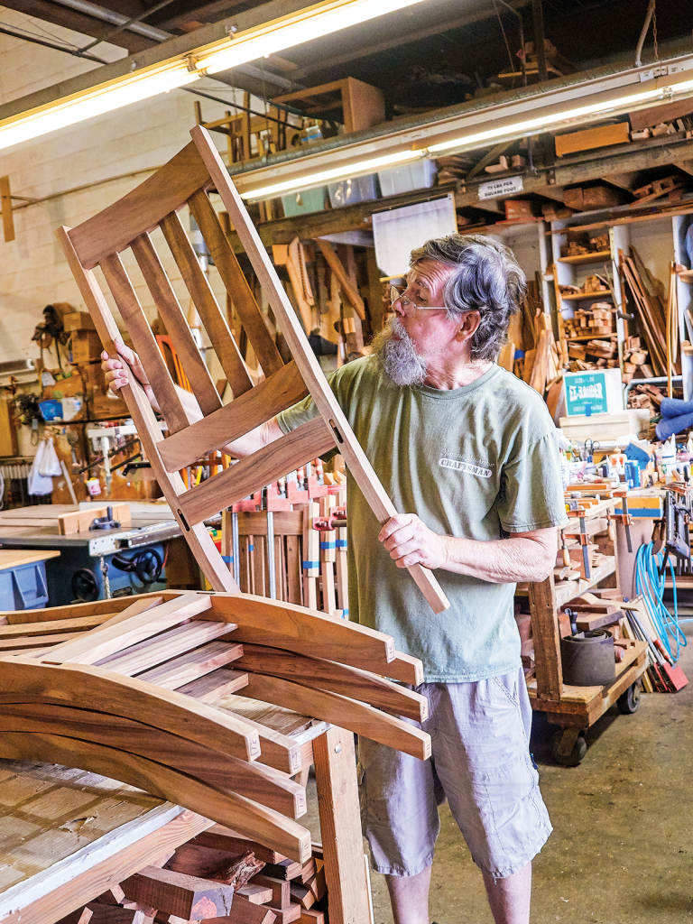 Master craftsman Don Heim creates eight solid, curly koa dining chairs. Photo by David Croxford