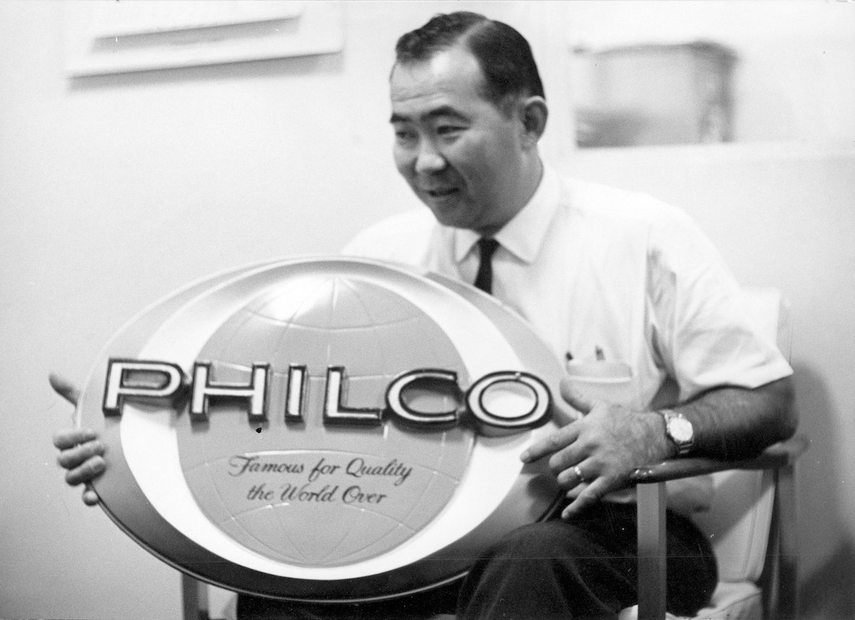 george fukunaga, mark's father, with a Philco sign, one of the brands that Easy Appliances sold.