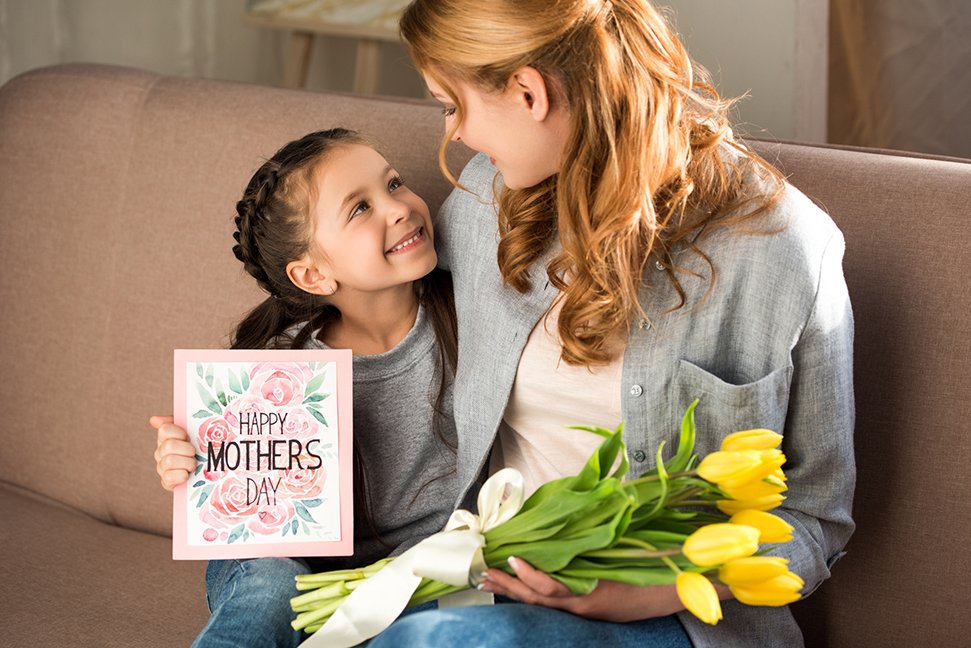 child giving mother gift on mothers day