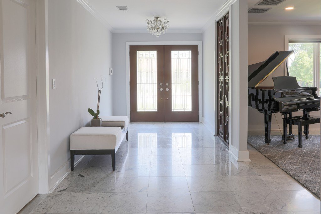 Entrance Way To Luxury Home With Piano