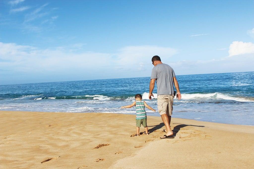 family on molokai walking on the beach