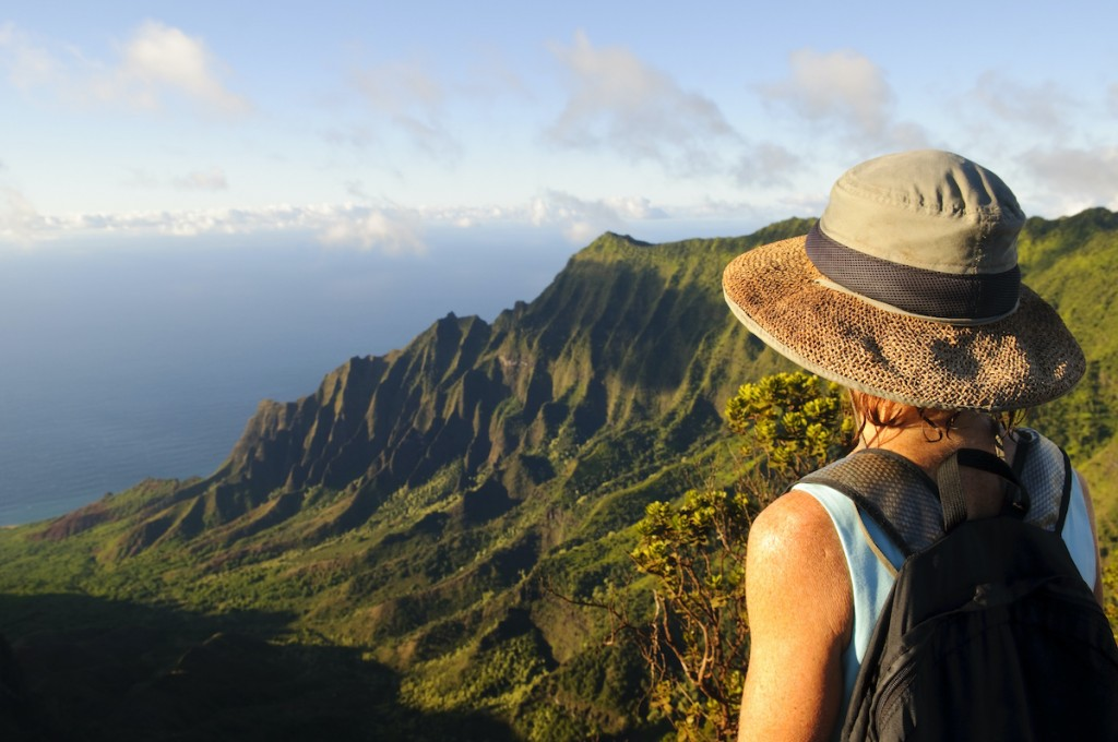 Woman Outdoors Looking At Dramatic View And Future On Kauai