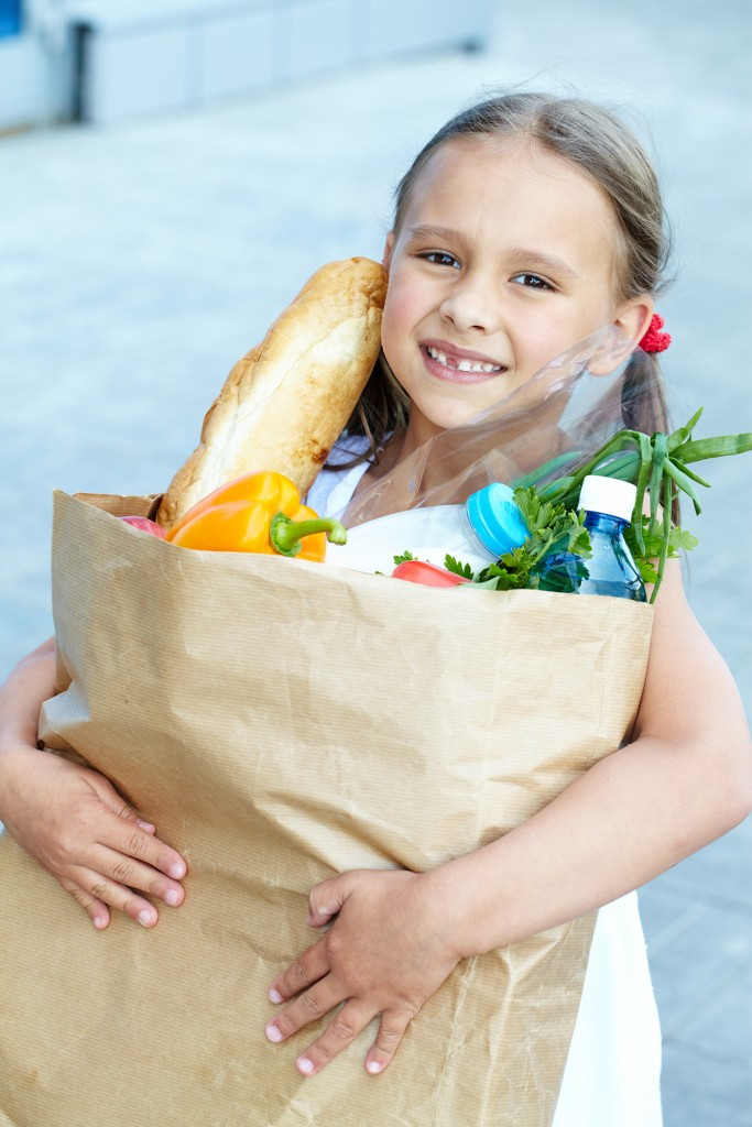 Portrait Of A Little Girl With Foodstuff