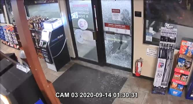 Surveillance Video Of Suspects Breaking Into Casey's