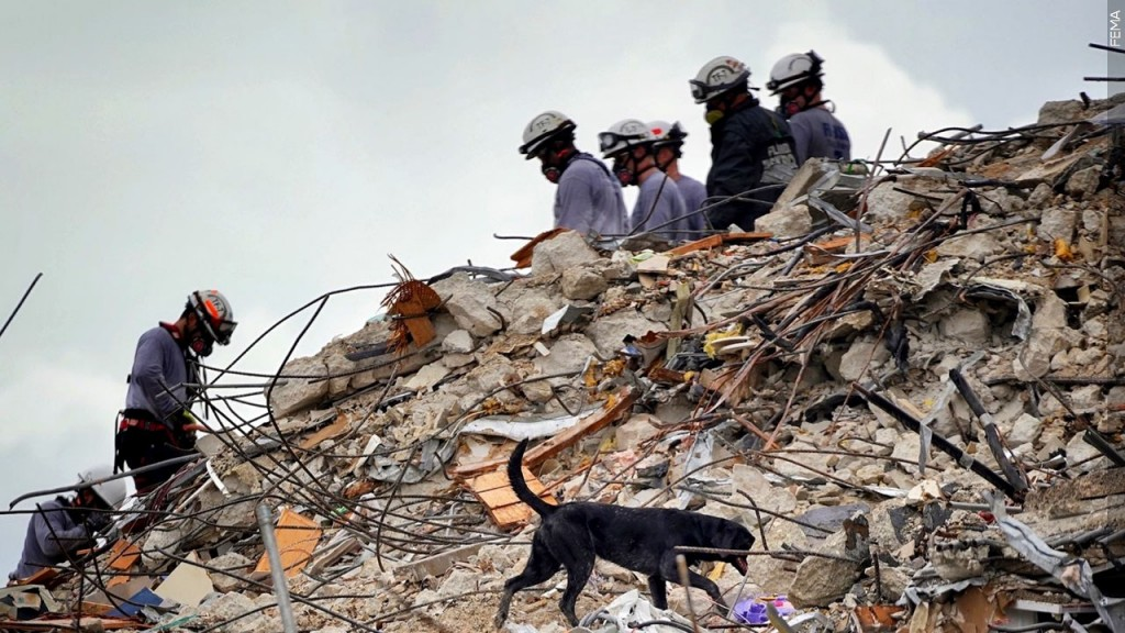 Rescue workers dig through debris at the Surfside condo collapse