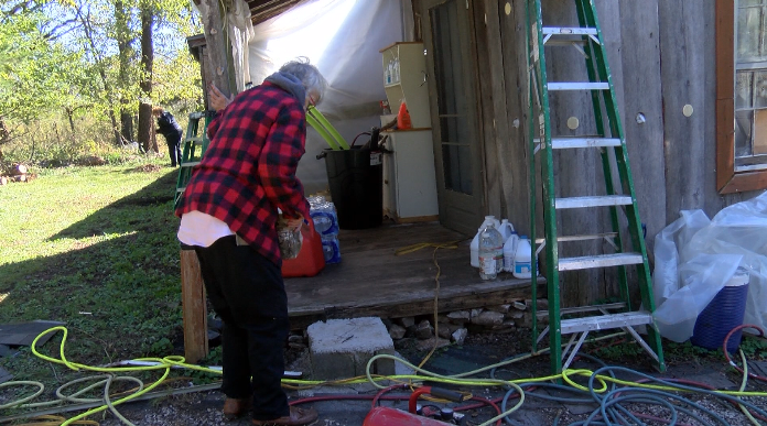 Community comes together to give elderly woman a new roof and running water