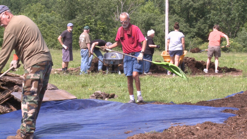 Volunteers clean up trails after flooding