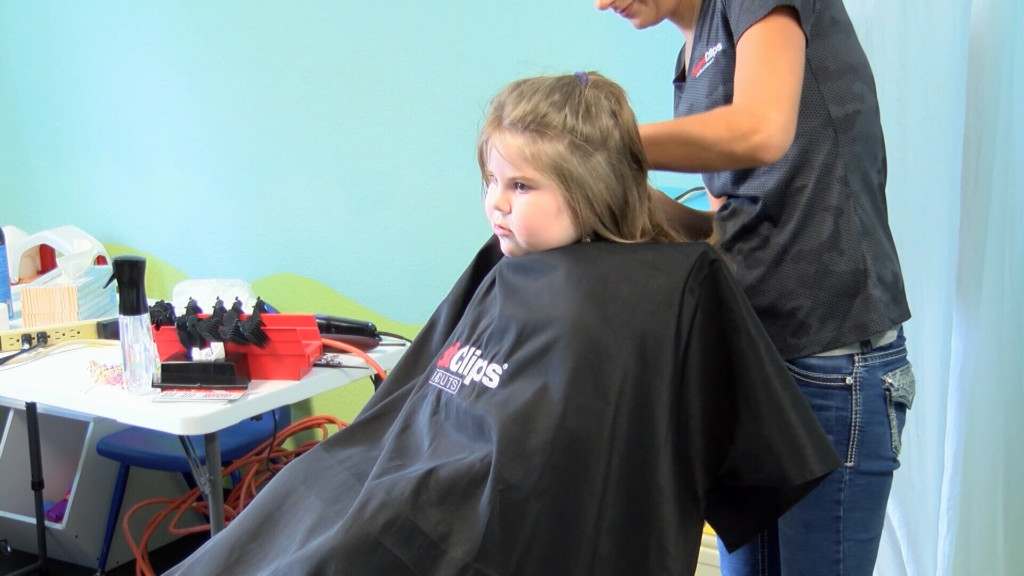 School supply giveaway and free haircuts ease financial burden for parents