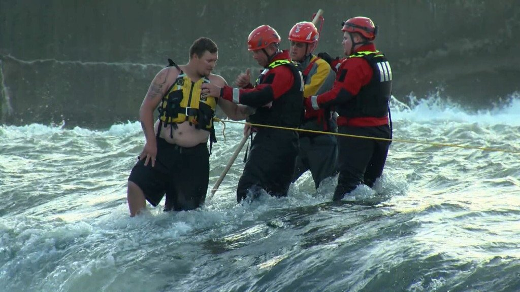 Water rescuers free a man stuck in the Grand Falls