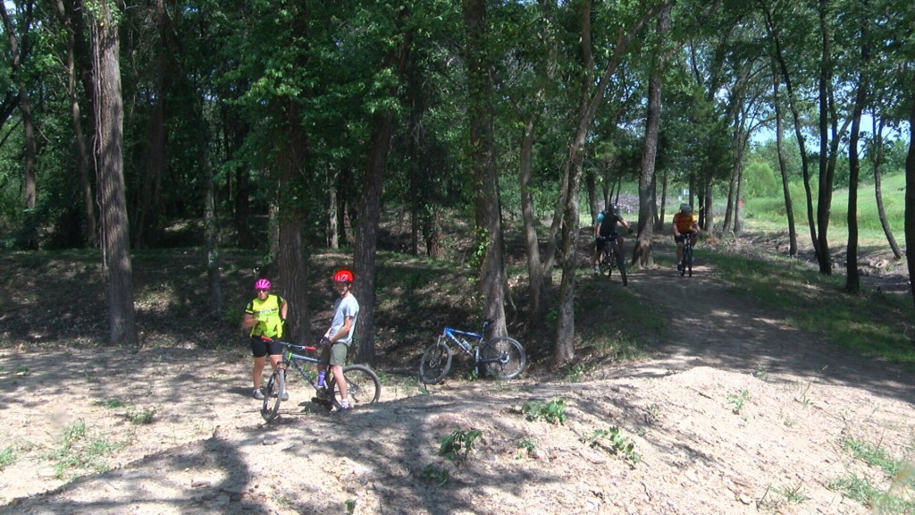 Community comes together to conquer overgrowth at 23rd Street Bike Park