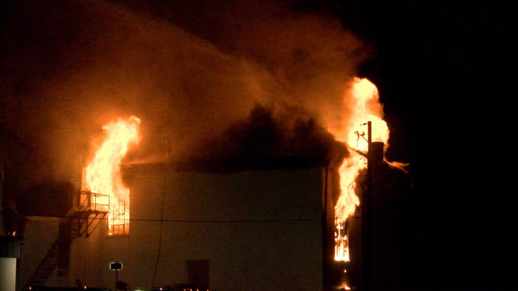 Crews fight fire at old Liberal High School