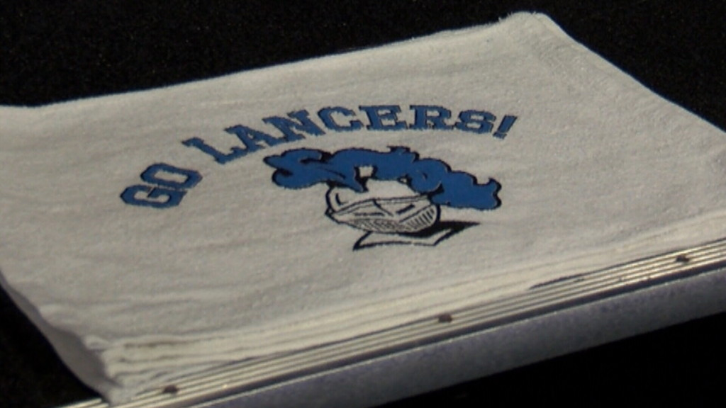 Students sell rally towels to raise funds for digital sign
